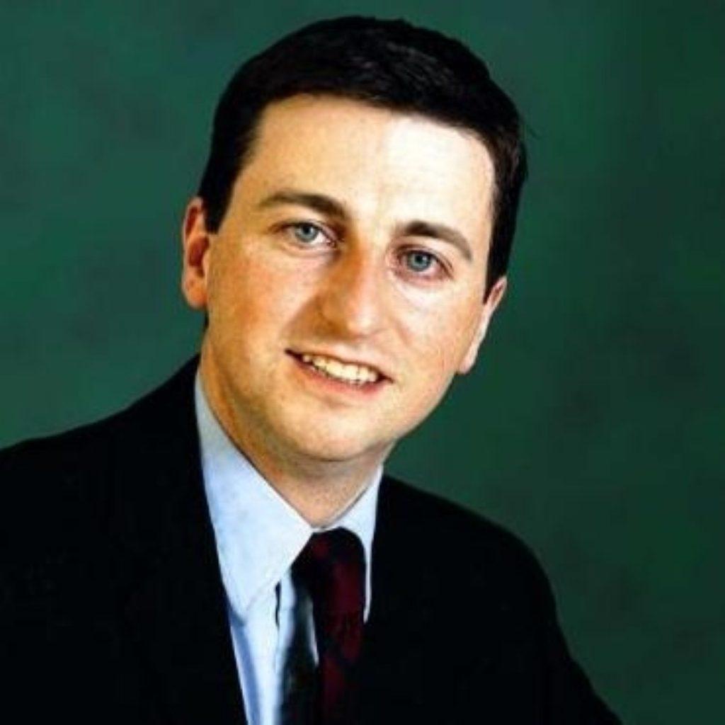 Transport secretary Douglas Alexander backs national road tolls