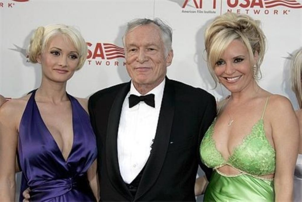 Hugh Hefner with two models. The Playboy founder is widely considered to have brought the industry some mainstream acceptibility.