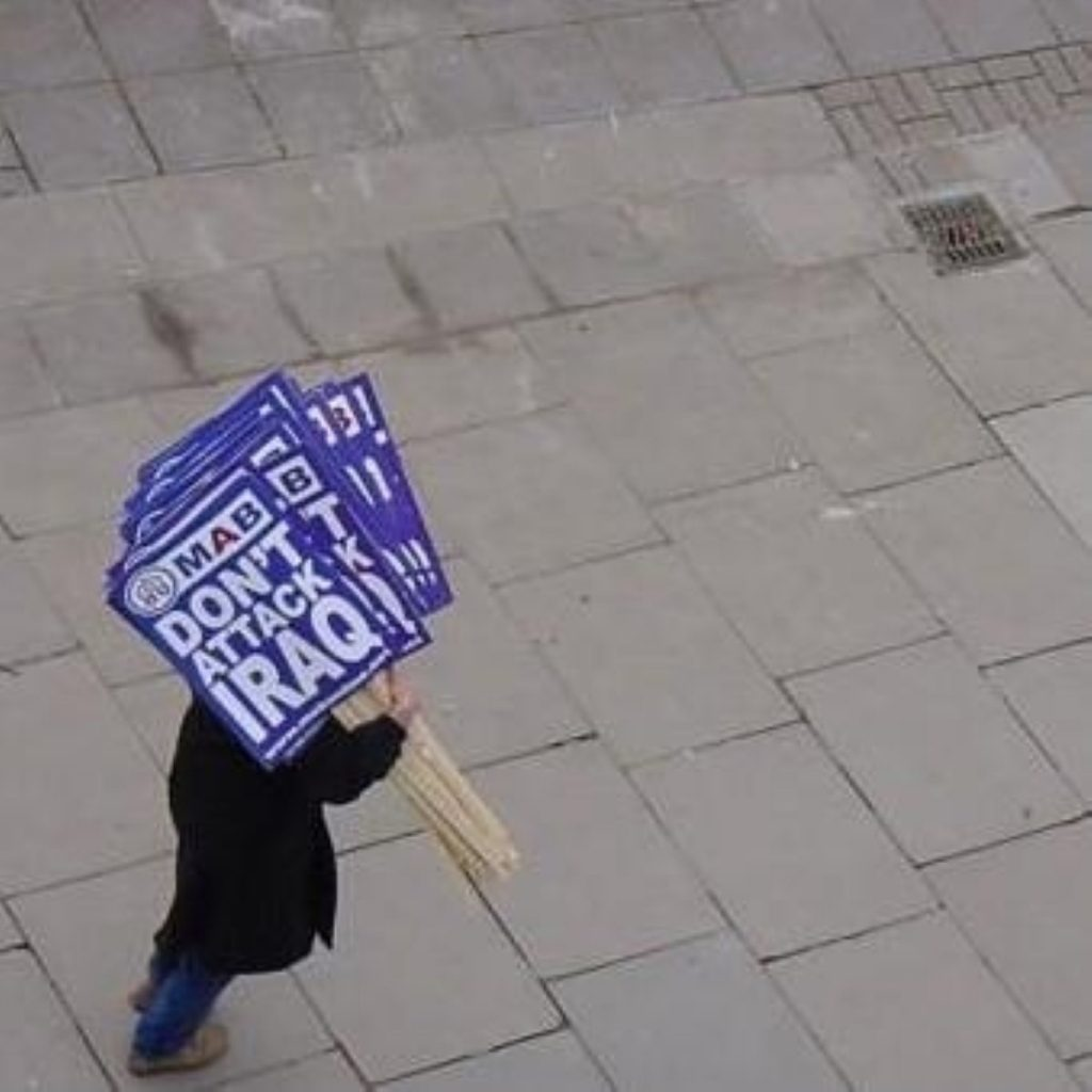 A demonstrator at a previous anti-war protest