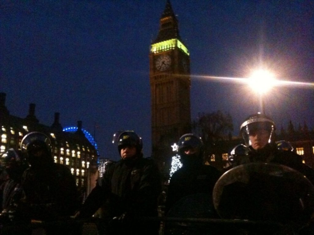 Police stand guard during the student protests last December