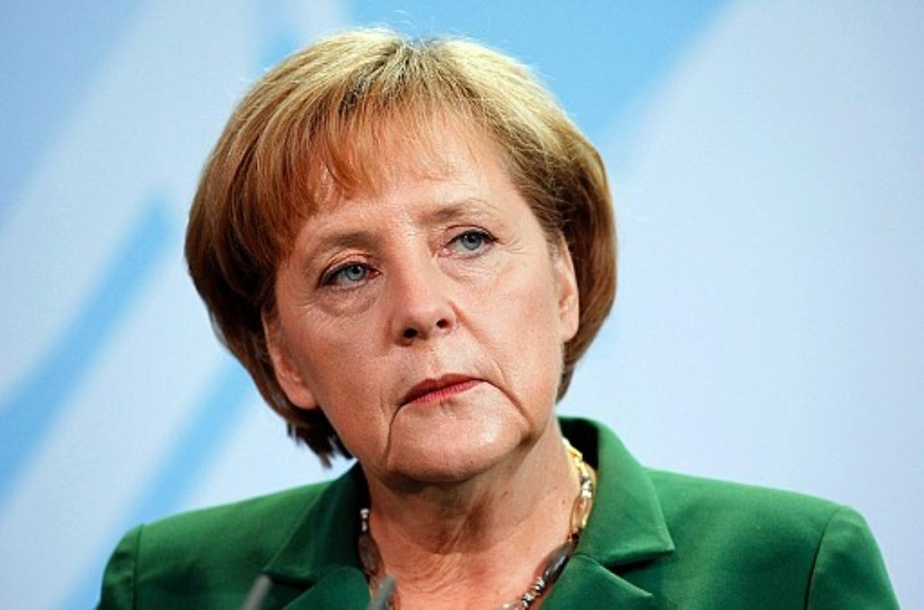 Unimpressed: Merkel was watching Wagner when the naked drug taker boarded her plane.