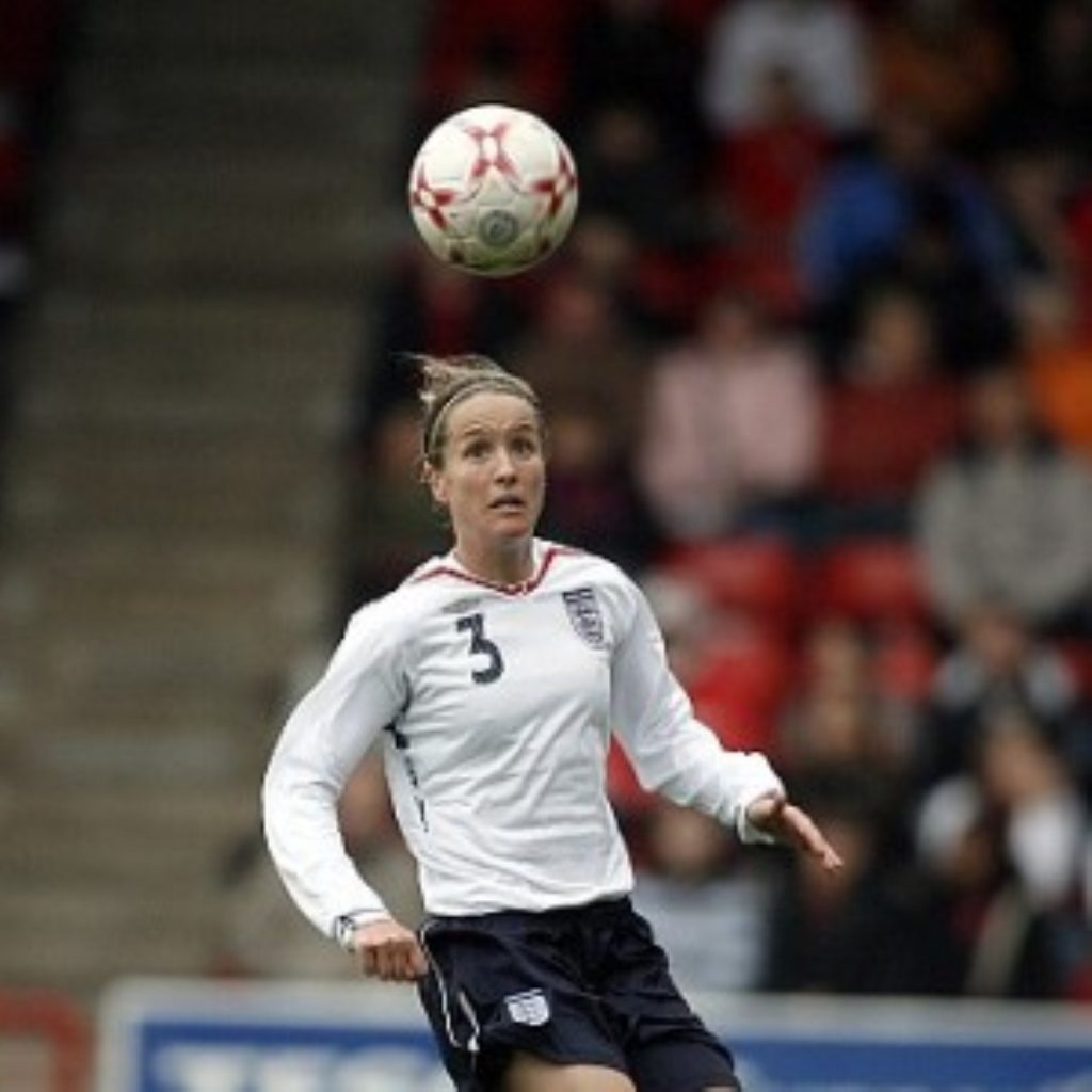Casey Stoney headers a ball for England. Women's football still does not receive significant attention from sports fans.