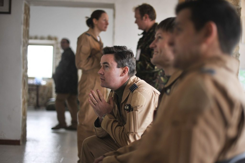 An RAF pilot prepares for a mission over Libya after a briefing in Gioia Del Colle, Italy