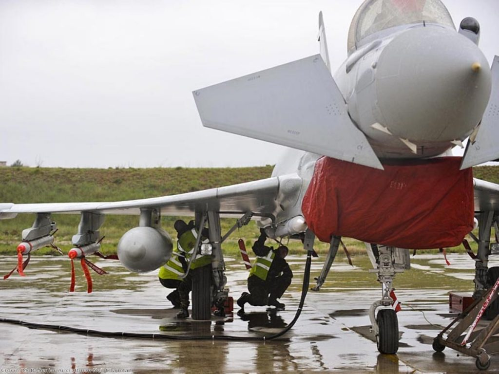 RAF ground crew prepare a Typhoon for action over Libya