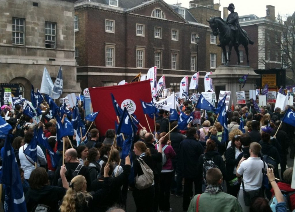 Protesters march down Whitehall during the March for the Alternative