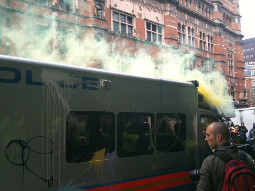 Police van is targeted by anarchists in central London