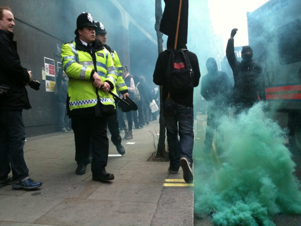 Police deal with anarchist protestors in Soho during the anti-cuts rally