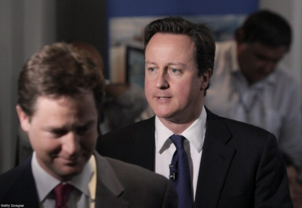David Cameron and Nick Clegg speak with NHS staff in Surrey