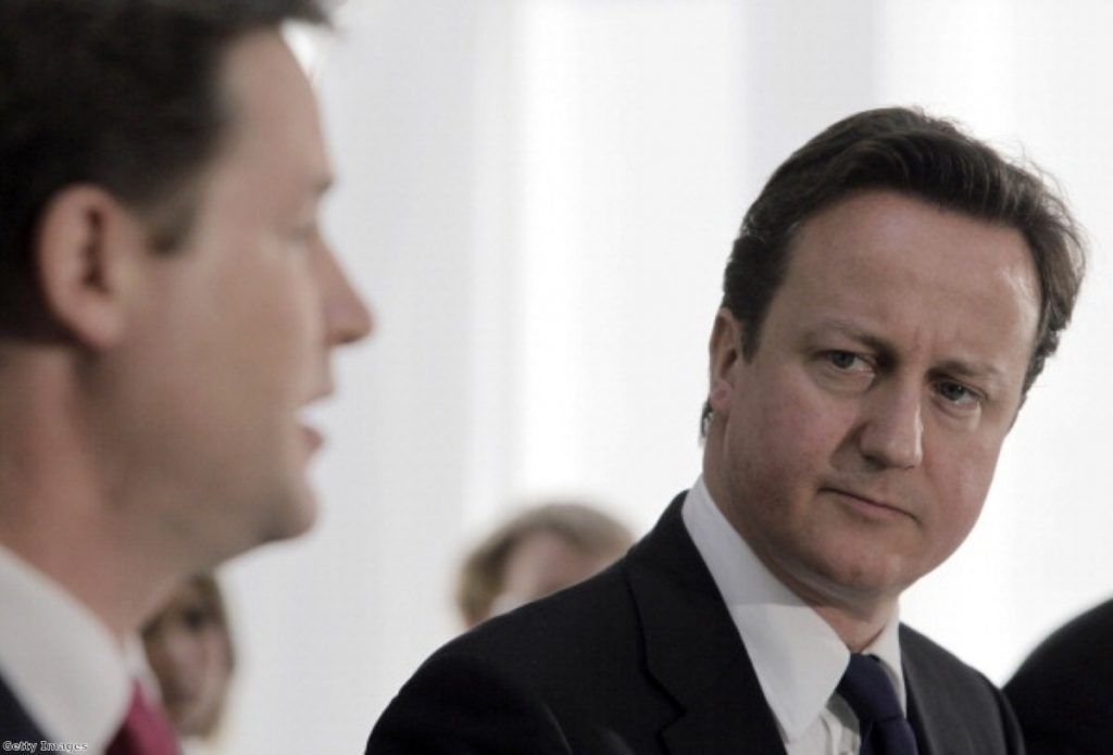 Cameron looks on at Clegg during a health reform Q&A last month