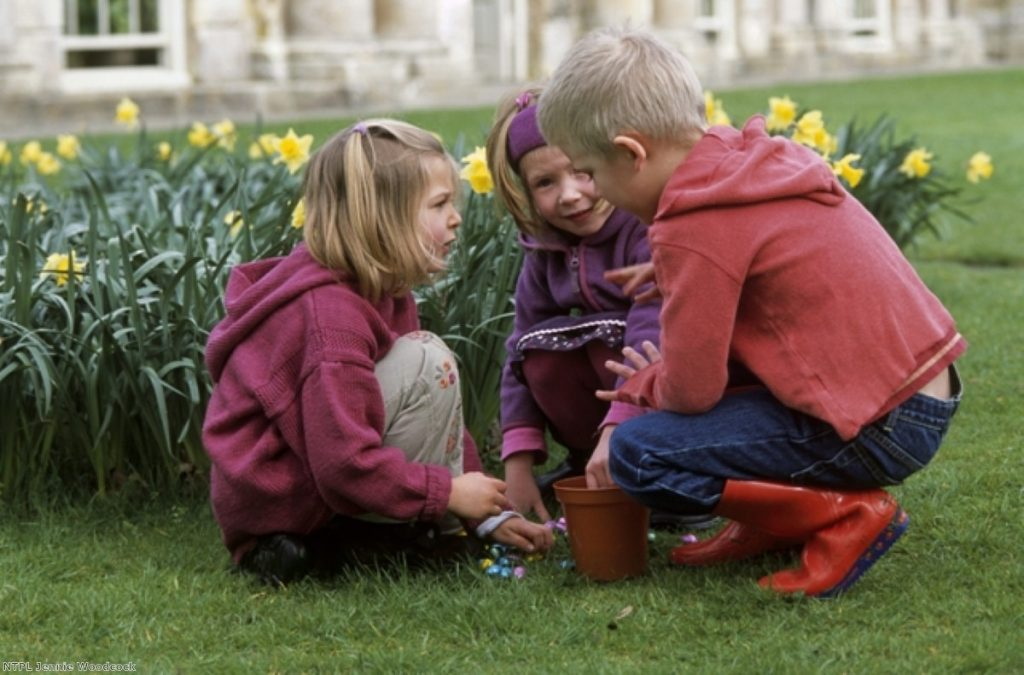 Children play during a National Trust Easter egg hunt. The charity is angry at being branded left-wing by a minister.