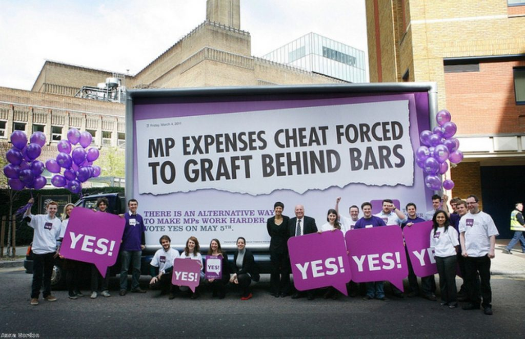 A Yes To Fairer Votes poster highlighting MPs' `complacency`. Photo: Anna Gordon