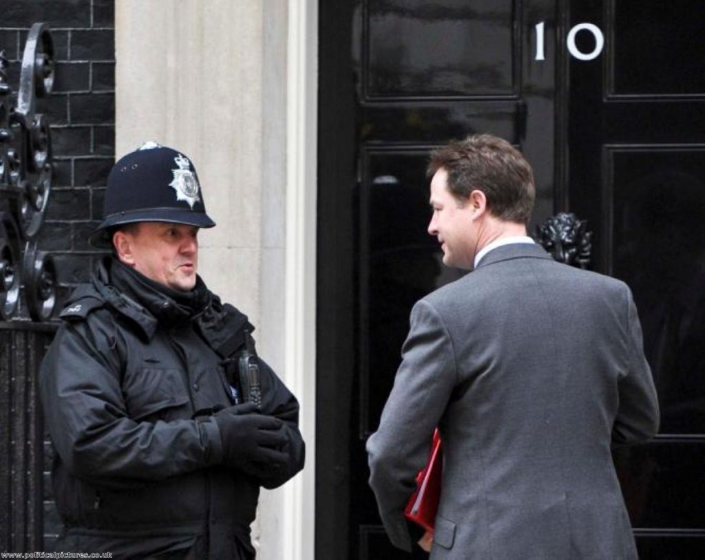 Clegg chit-chats with a policeman on duty outside No 10. Photo: Political Pictures