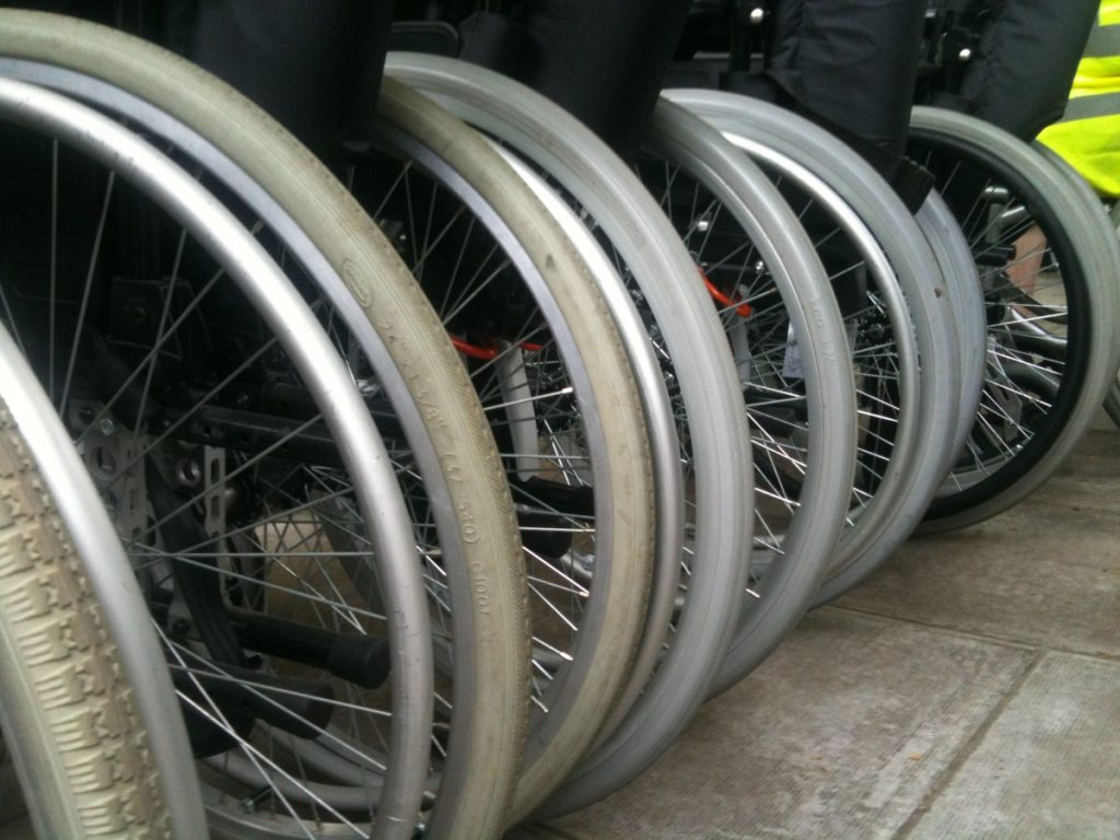 Wheelchairs line up at the protest in Westminster today.