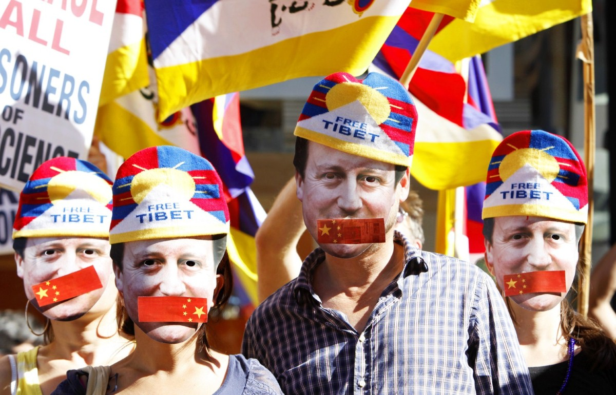 Protestors symbolise David Cameron's silence over human rights during a protest yesterday.