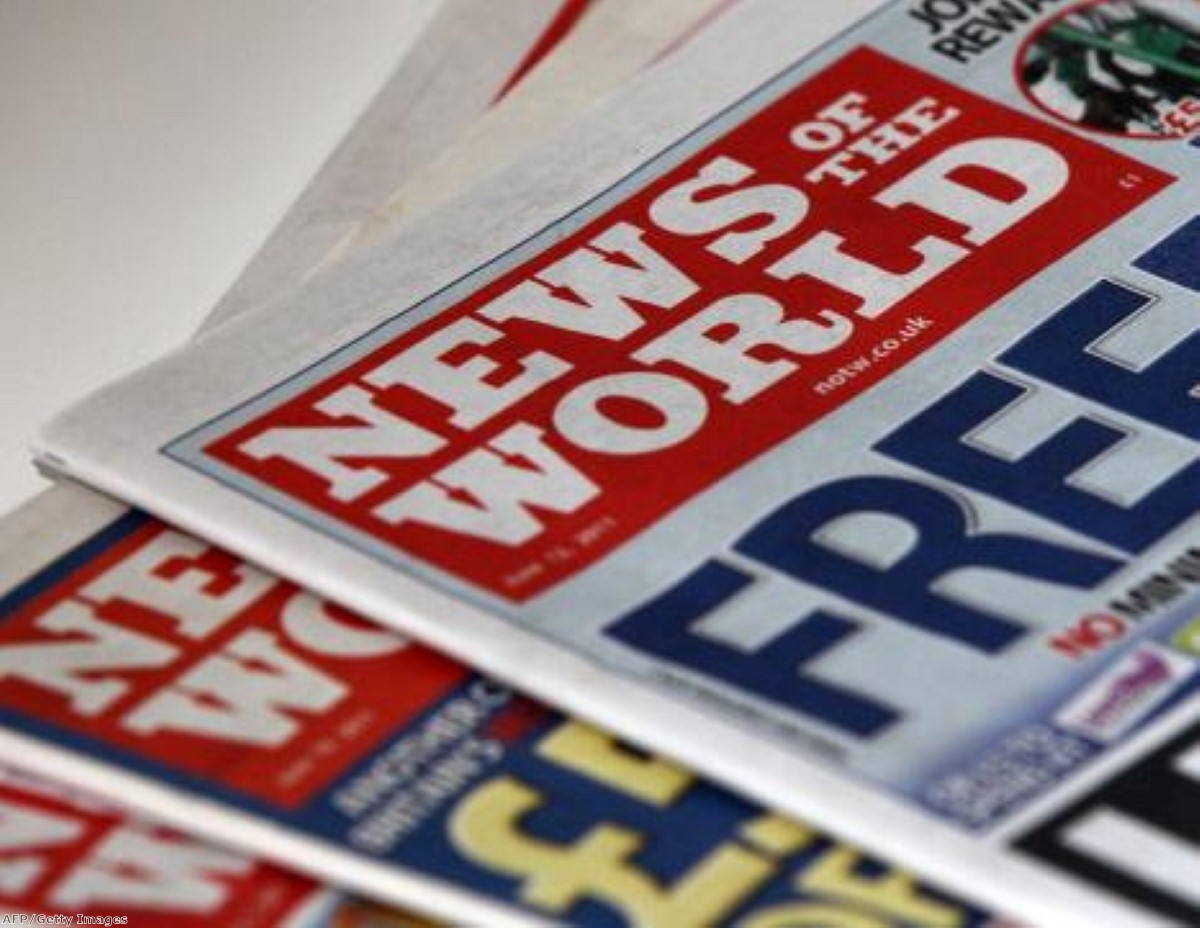 The News of the World's former editor is now engaged in a war of words with his former employer.