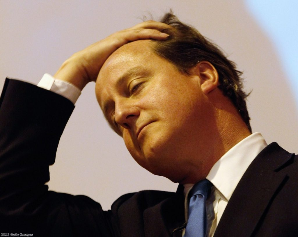 Under pressure: The phone-hacking scandal is threatening Cameron's reputation.