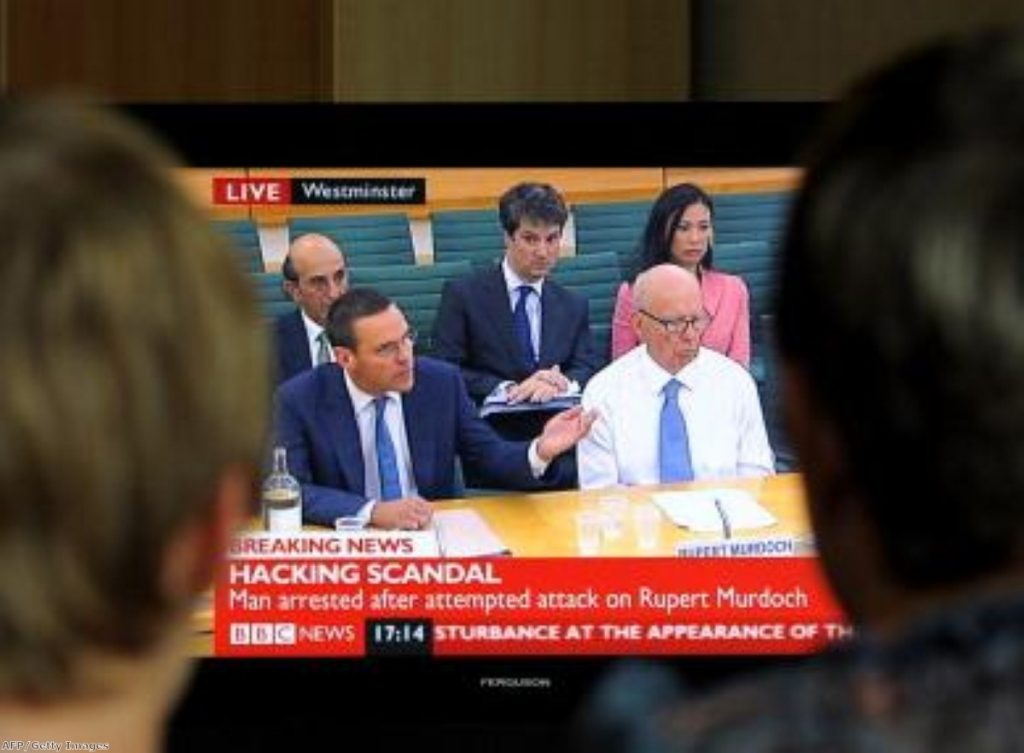 James Murdoch and his father Rupert appear before MPs last summer