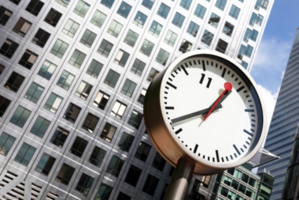 Time for reform? A clock watches over Canary Wharf, where the banking sector has been on overdrive in recent weeks.