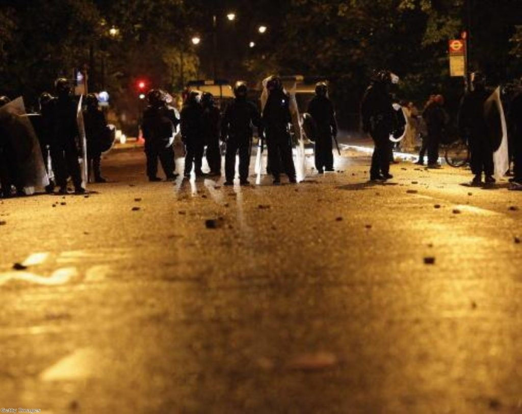 Police are confronted by several hundred youths in Brixton last night