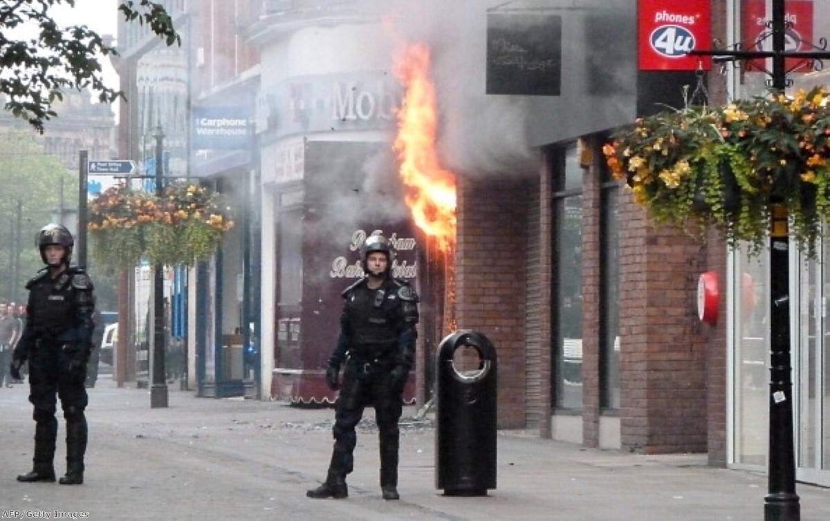 A fire rips through a shopping mall in Manchester during the height of the riots.