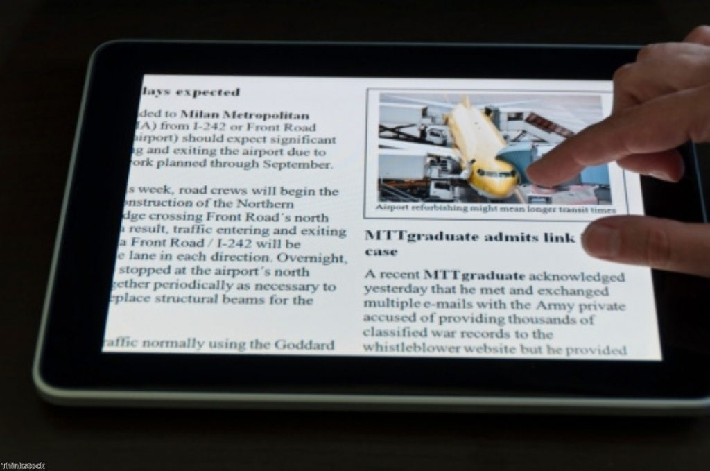 Many readers increasingly use the iPad to keep up with the news.