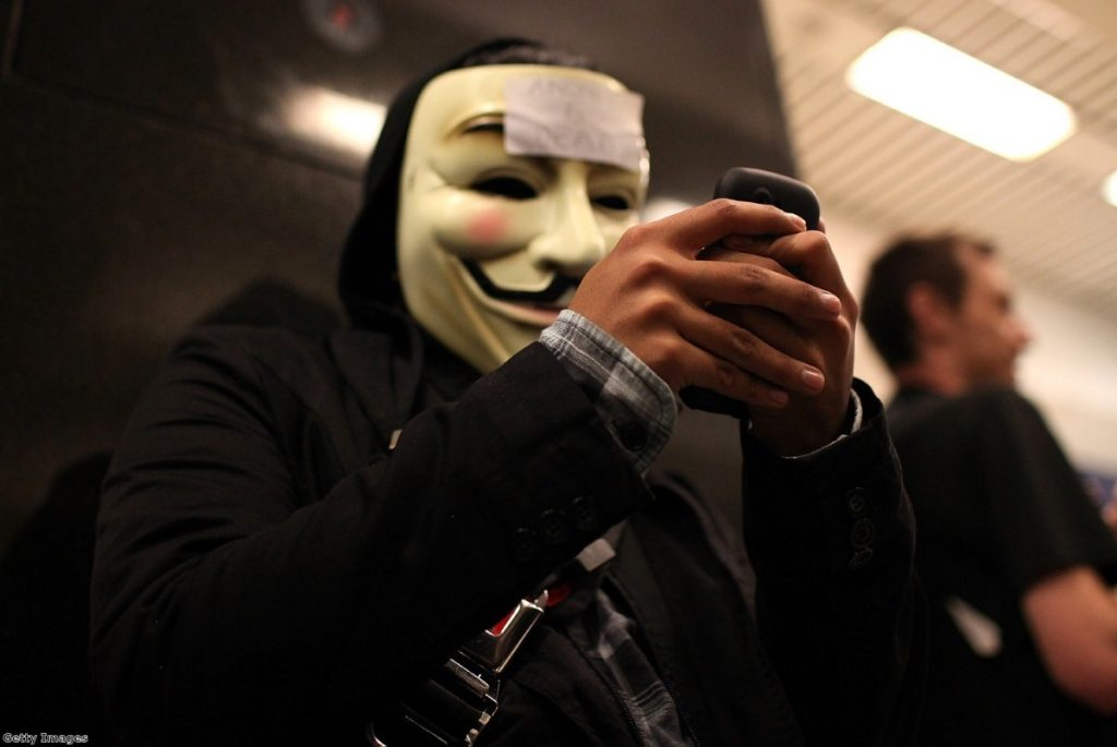 A demonstrator tries to use his phone during a protest in San Francisco in 2011. Civil liberties campaigners warn the snoopers' charter plans give too many powers to authorities.