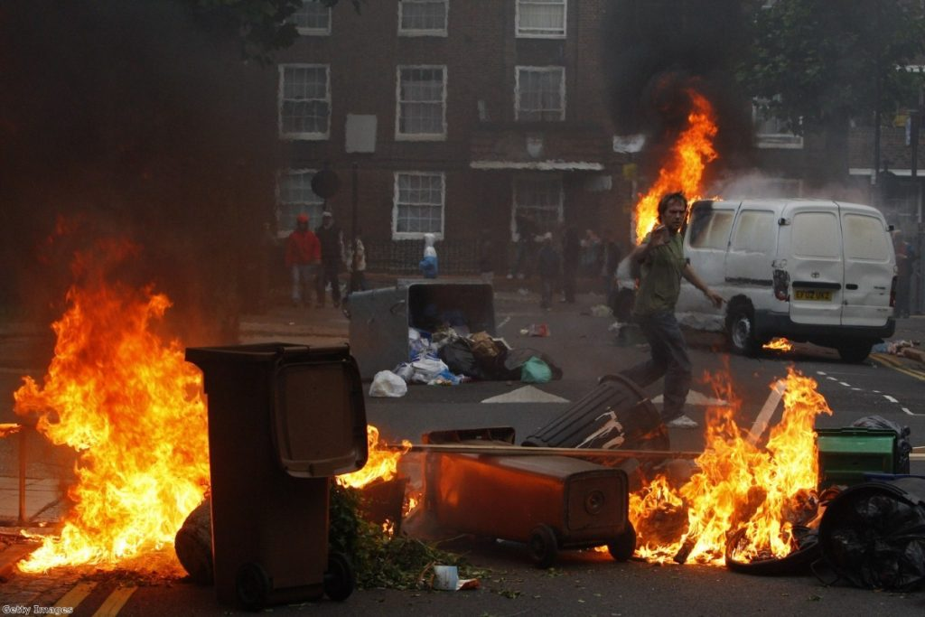 Riots and looting spread from London to cities across England in August 2011