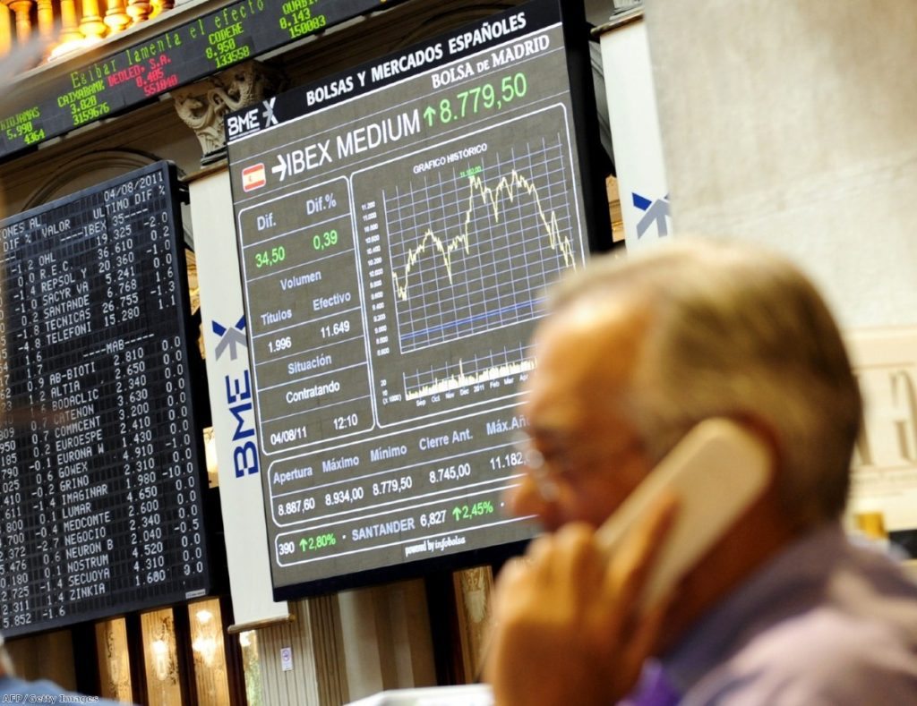 A trader on Madrid's stock exchange deals with the consequences of the eurozone crisis - which shows no signs of abating