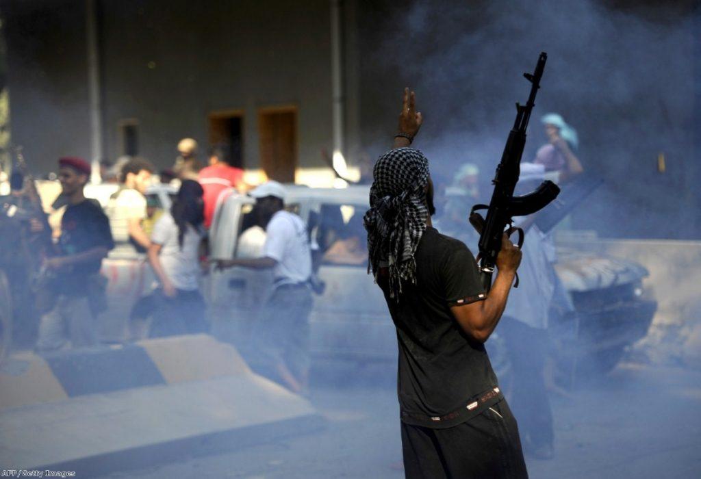 A Libyan rebel celebrates inside the captured military base, 'Kilometre 27'