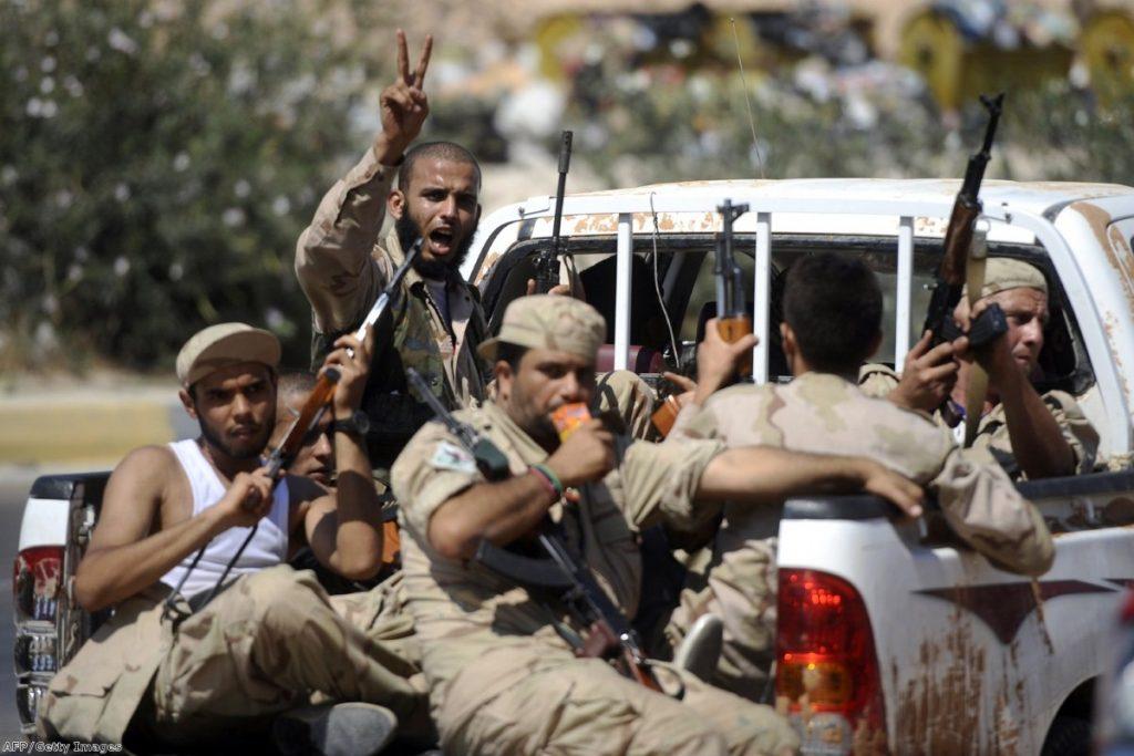 Rebel fighters ride along towards Jdaim, west of Tripoli, earlier this week.