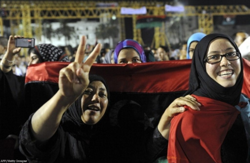 Libyan women celebrate with the new Libyan flag at Martyrs Square in downtown Tripoli last August.
