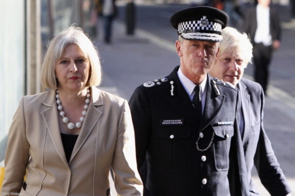 Bernard Hogan-Howe stands next to home secretary Theresa May and London mayor Boris Johnson. He is taking a more hardline stance on drugs than many of his contemporaries.