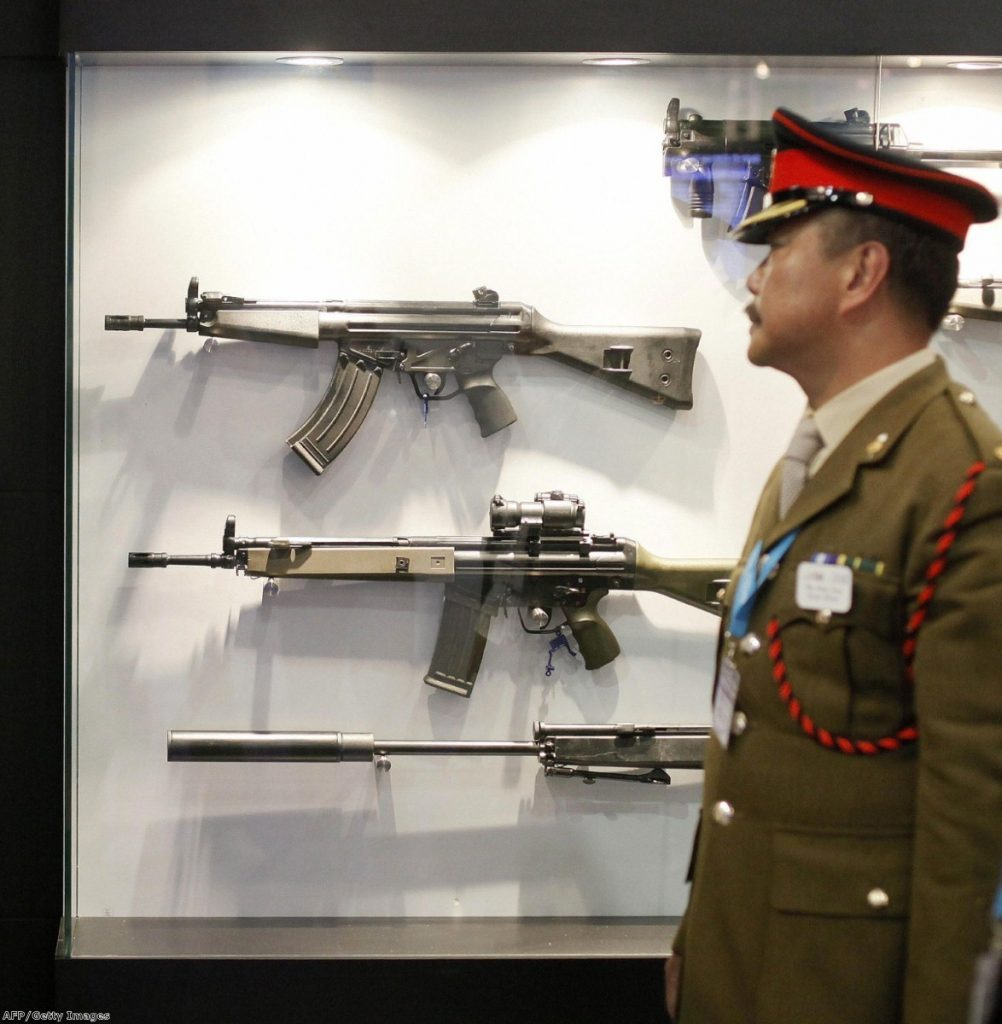 A member of the Chinese military delegation visits the Defence Systems and Equipment International Exhibition (DSEi) in east London, on September 8, 2009.