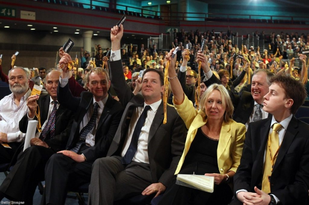 Clegg votes at the Lib Dem party conference