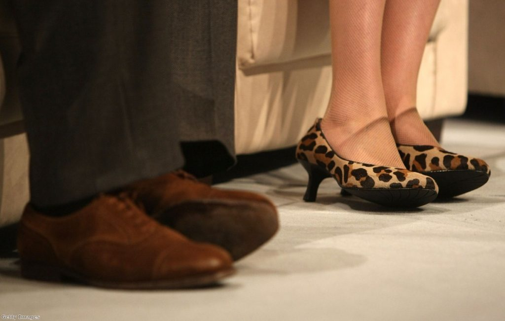 Clarke's suede shoes sit beside May's animal print high heels during happier times