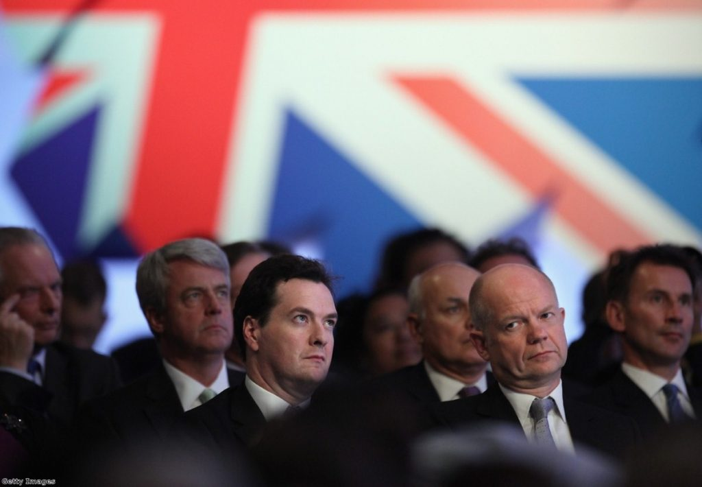 Cabinet secretaries watch Cameron's speech, which spent some time mocking them.