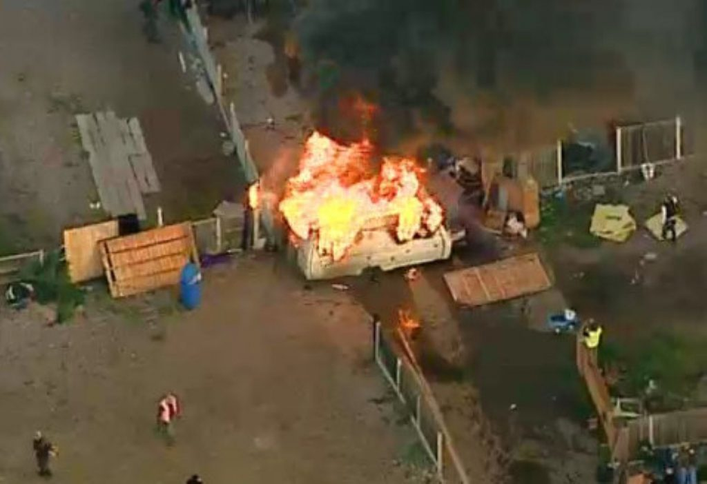 A caravan is set on fire during the eviction at Dale Farm