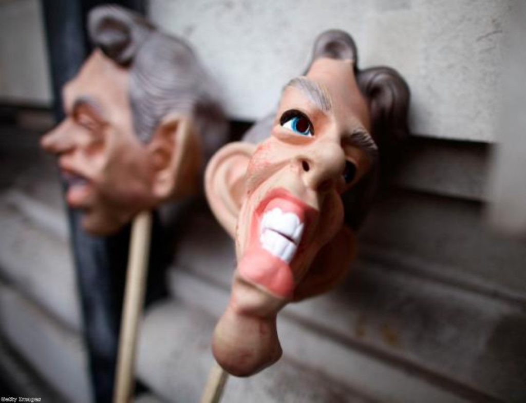 Masks of Tony Blair outside the Iraq inquiry, where the former PM gave evidence. Secret details of his discussions with George Bush are now set to be released
