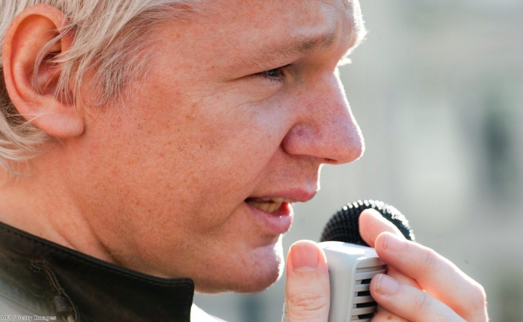 Julian Assange speaks to the crows during a recent Occupy London protest
