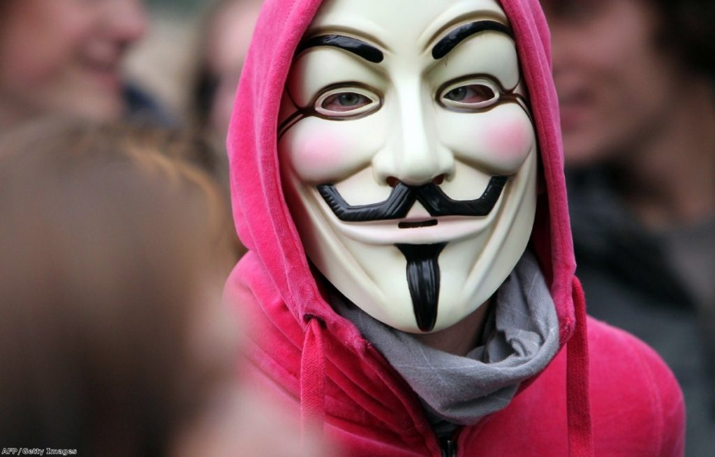 A protester in Frankfurt wears the V-mask, which has become synonymous with the Occupy protests