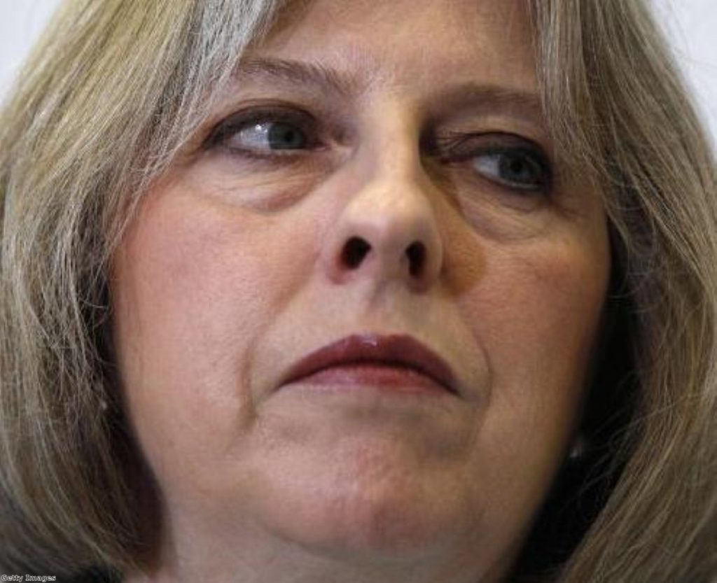 May: Under pressure from repeated Clegg attack on exit checks