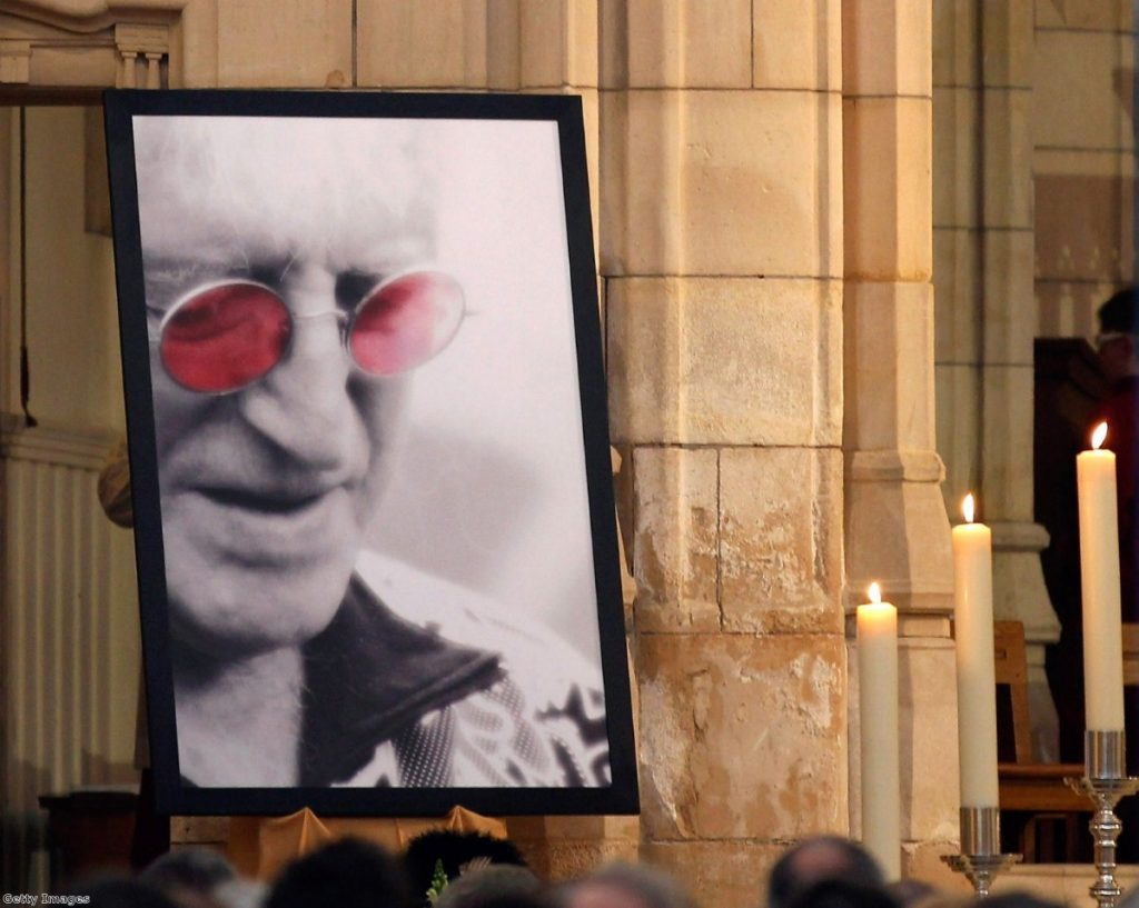 Jimmy Savile looks down at his own funeral in 2011