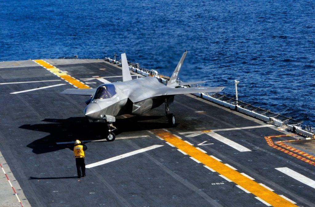An F35-B aircraft lands on a US Navy vessel