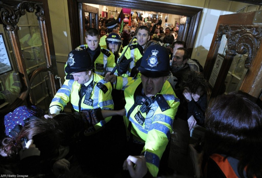 Police challenge UK Uncut demonstrators during a protest in central London last year.