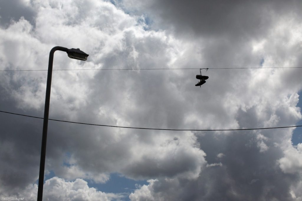Trainers hang from telephone wires near the corner of Granby Street and Selborne Street where the arrest of Leroy Cooper sparked off the Toxteth riots.