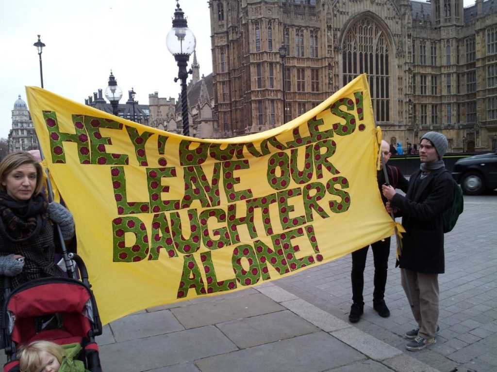 Protesters attend the demo outside parliament today