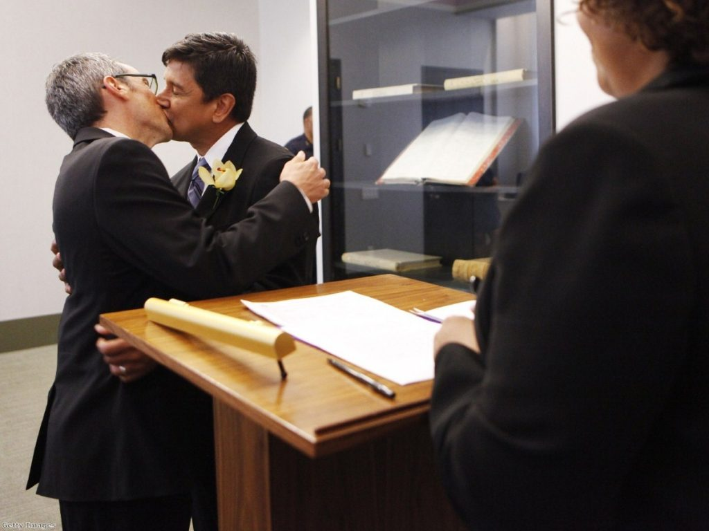 A gay couple marry in New York. Moves to legalise gay marriage in Scotland have triggered an unseating strategy