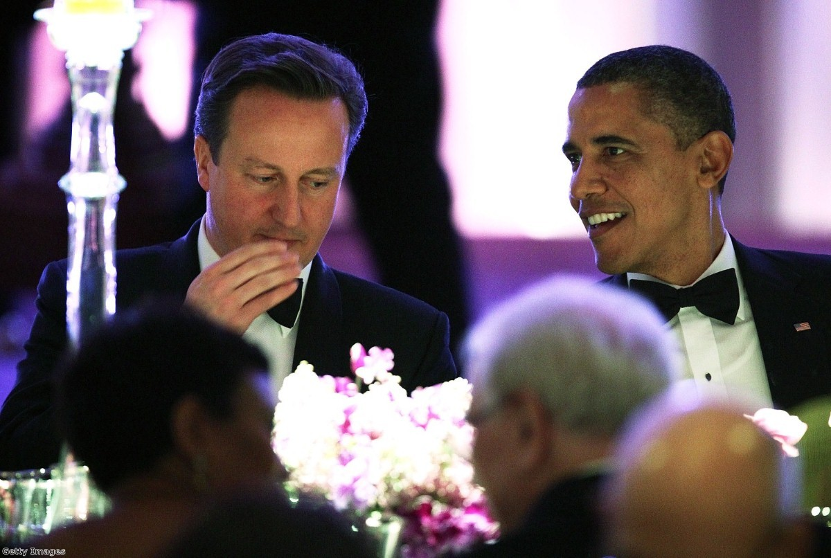 Cameron and Obama share a joke during last night's state dinner.