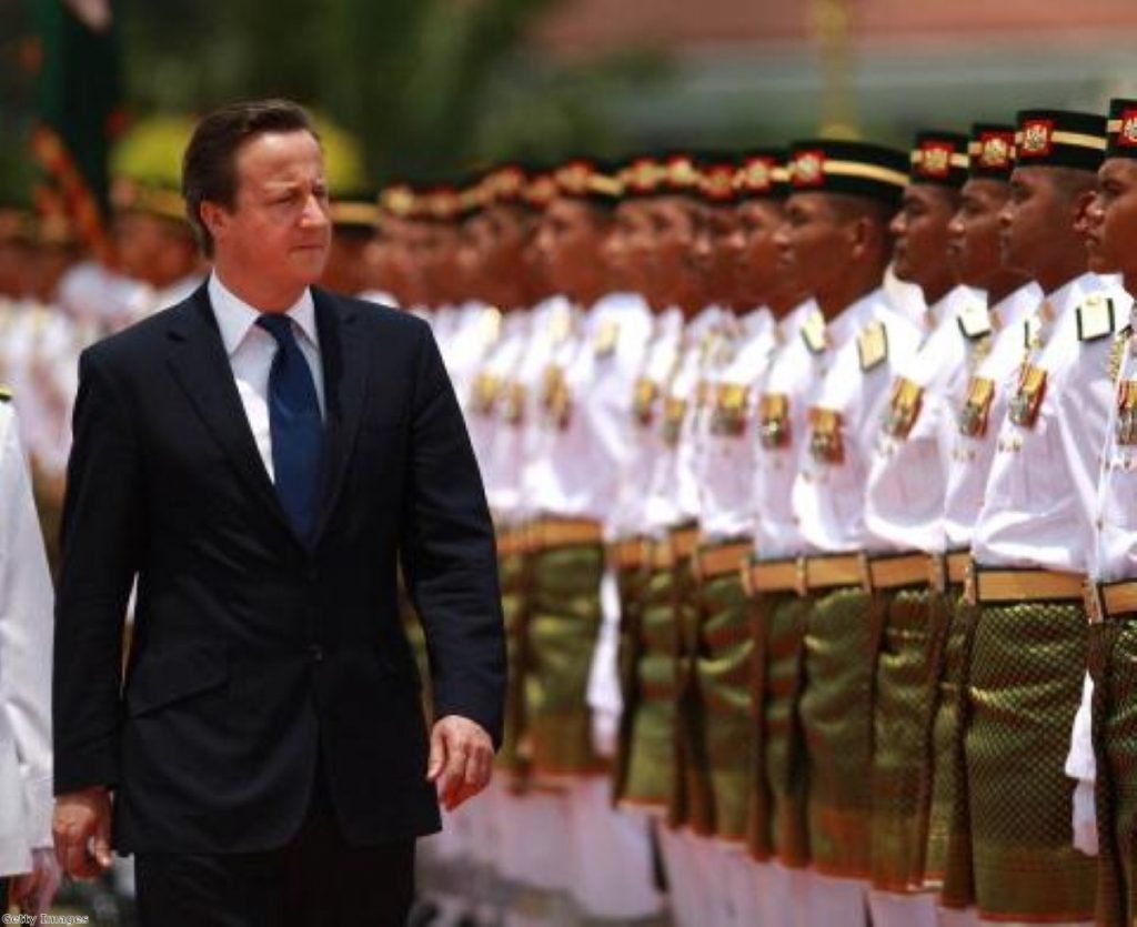 David Cameron inspects a guard of honour in Malaysia