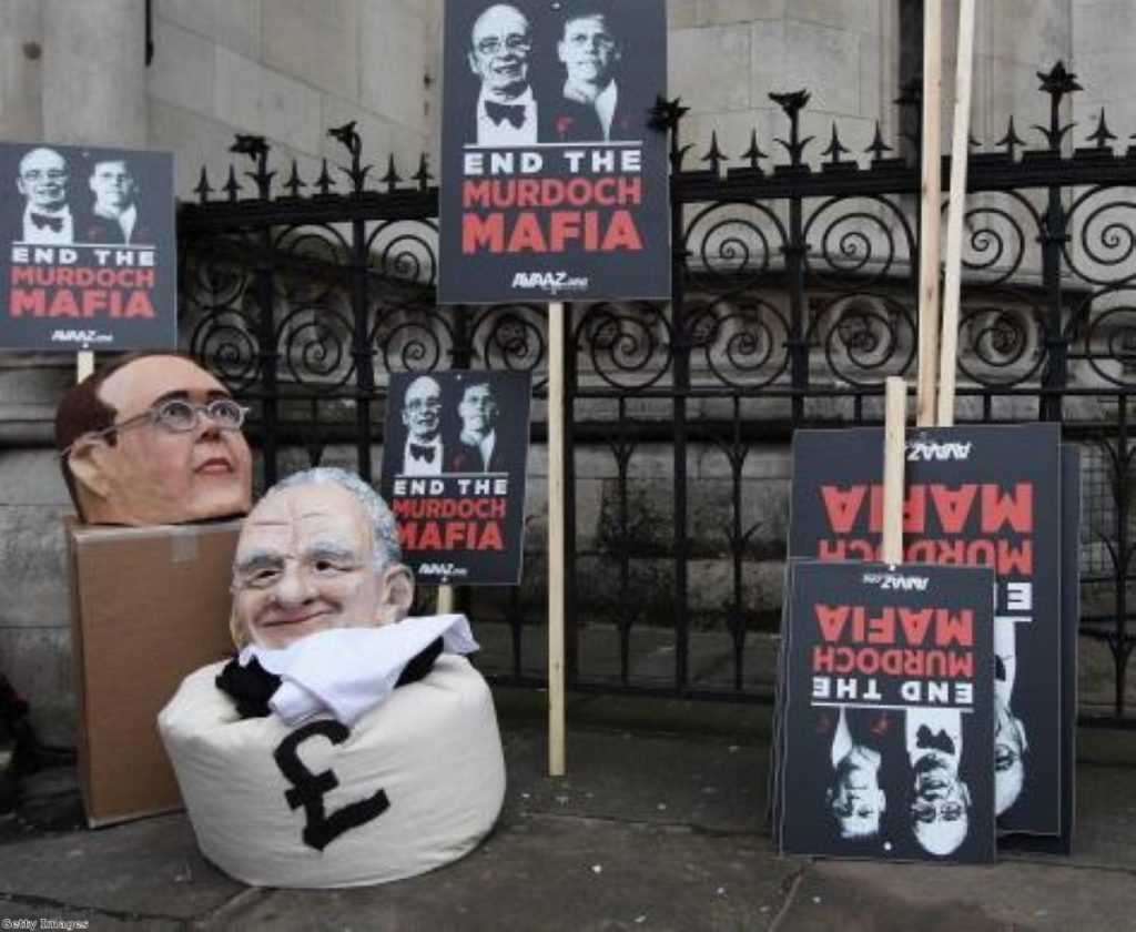 Protesters from the campaign group 'Avaaz' demonstrate outside the high court